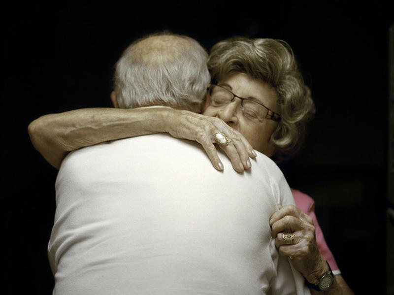 couple old embrace