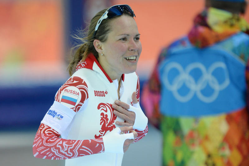 Russia's Olga Graf celebrates after wining the bronze medal in the Women's Speed Skating 3000m at the Adler Arena during the Sochi Winter Olympics on February 9, 2014. Dutch speed skater Ireen Wust powered to victory in the women's 3,000m on Sunday, stealing gold from defending Olympic champion Martina Sablikova. AFP PHOTO / JUNG YEON-JE (Photo credit should read JUNG YEON-JE/AFP/Getty Images)